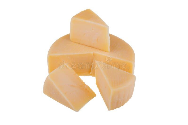 Roue jaune de fromage d'isolement sur le fond blanc image stock