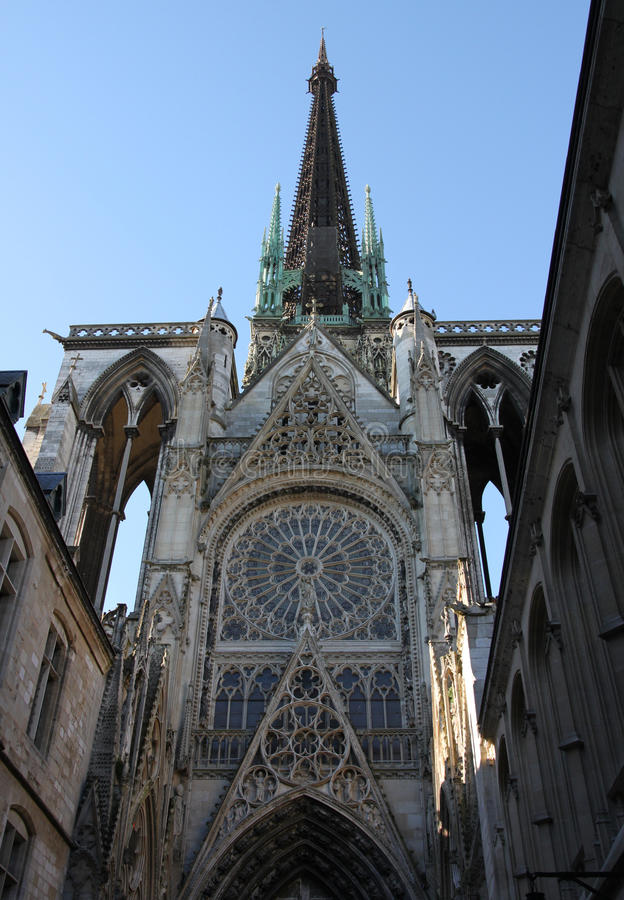 Rouen Cathedral in Normandy, France. View from the side street upwards towards the main spire. Rouen Cathedral is a Roman Catholic Gothic cathedral in Rouen stock images