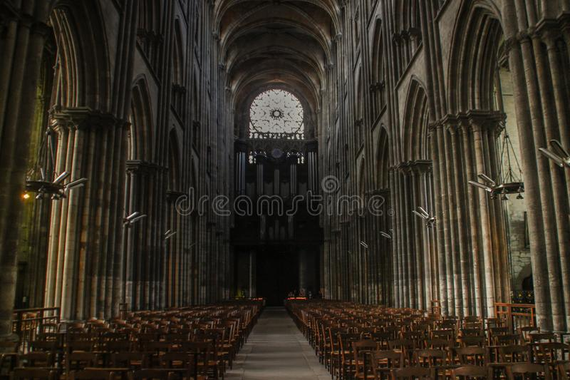 Columns and central view inside a beautiful medieval gothic cathedral in Europe royalty free stock image