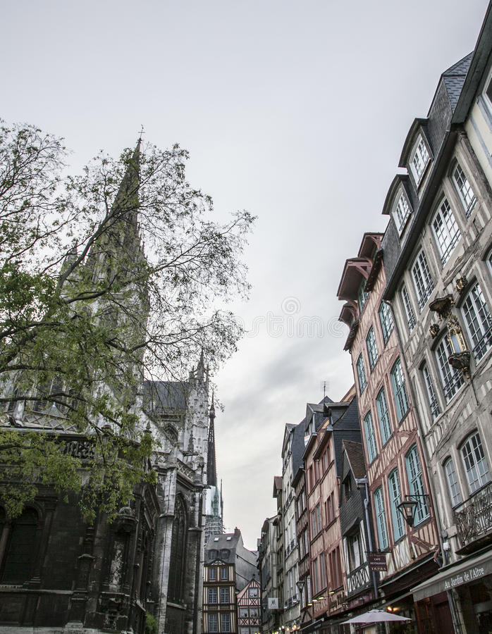 Rouen, Normandy, France - traditional townhouses and a church. royalty free stock photo