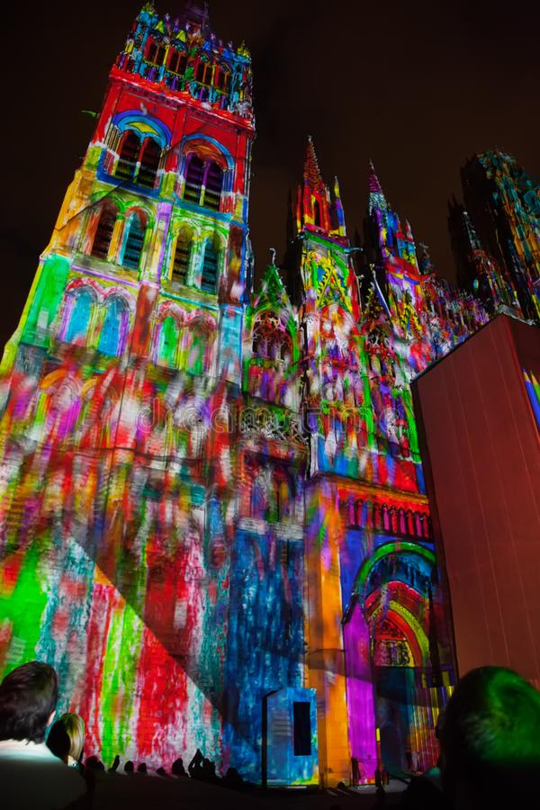 Rouen`s Cathedral Light show illuminates the gothic cathedral in the Normandy city of Rouen France late in the evening. Rouen`s Cathedral Light public show stock photo