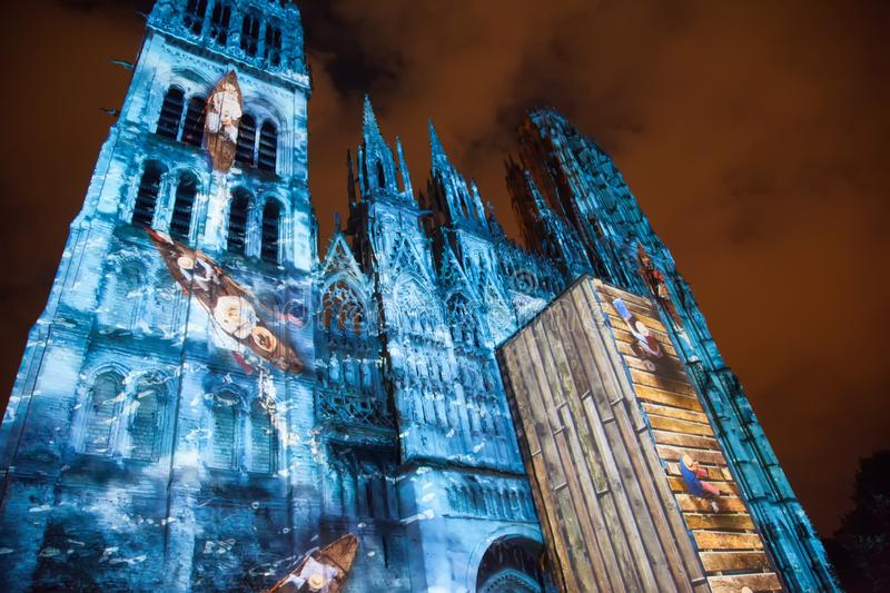 Rouen`s Cathedral Light show illuminates the gothic cathedral in the Normandy city of Rouen France late in the evening. Rouen`s Cathedral Light public show stock image