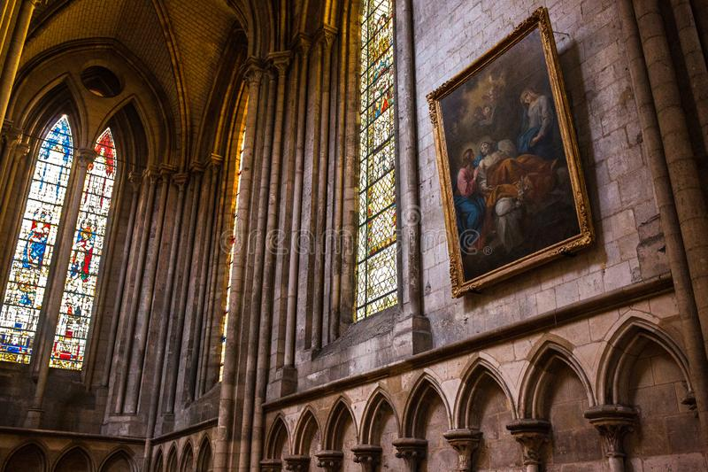 Rouen Saint Cathedrale interior view with sunlights. Ghotic church interior view with sunlights royalty free stock image