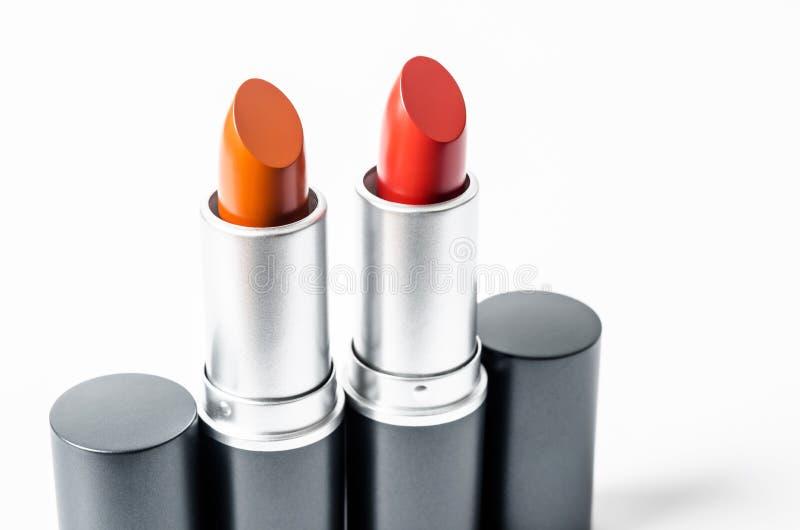 Rouge à lèvres rouge et orange de couleur images stock