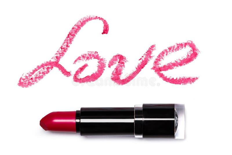 Rouge à lèvres rose avec AMOUR lattering images libres de droits