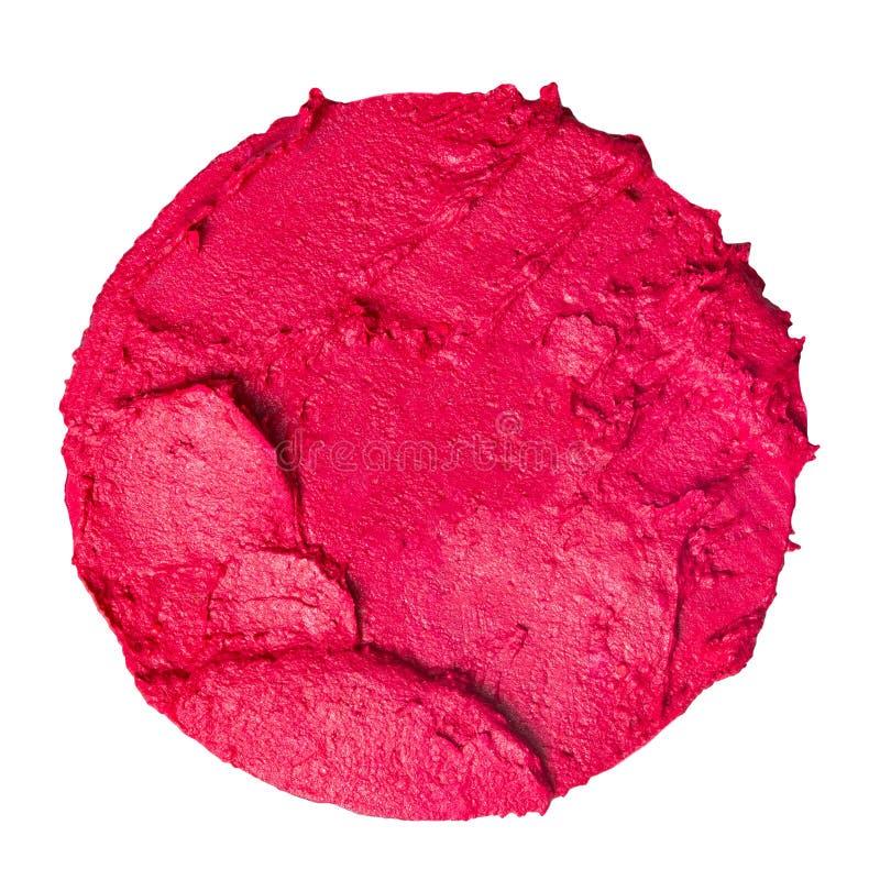 Rouge à lèvres taché sous forme d'un cercle d'isolement sur le fond blanc photos stock