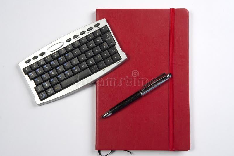 rouge de calculatrice de livre images libres de droits