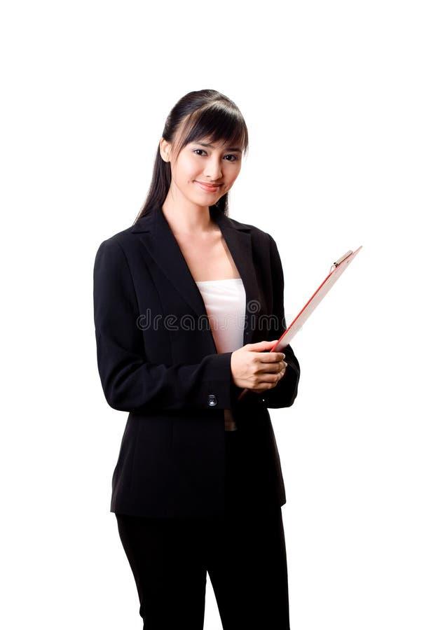 rouge de fichier de femme d'affaires avec a images stock