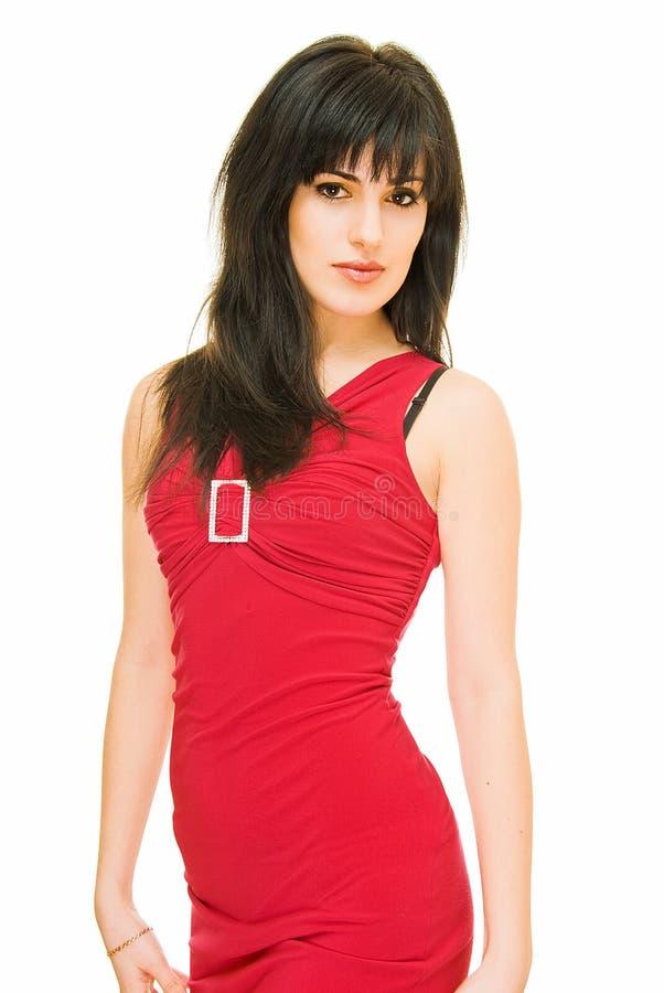 rouge de robe de brunette images libres de droits
