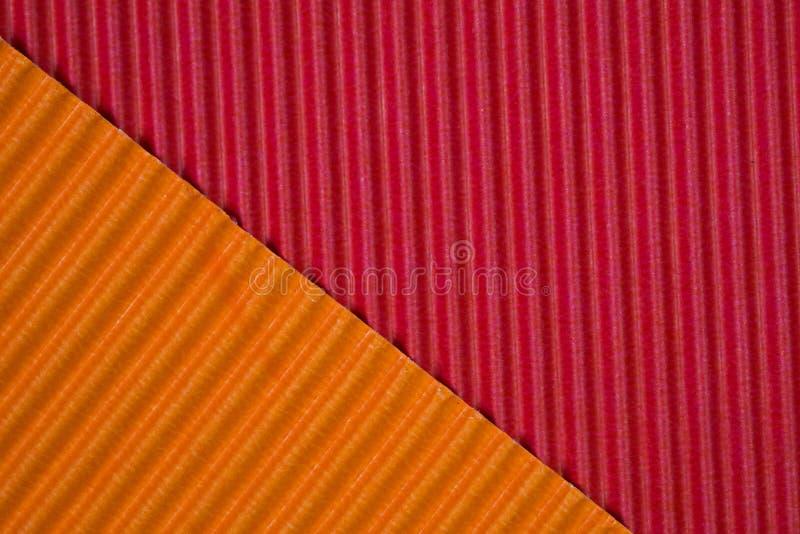 Rouge et texture de papier ondulée orange, utilisation pour le fond E photographie stock libre de droits