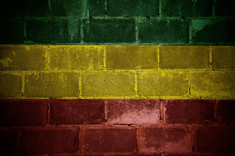 Rouge jaune vert sur le mur de briques, fond de reggae photographie stock libre de droits