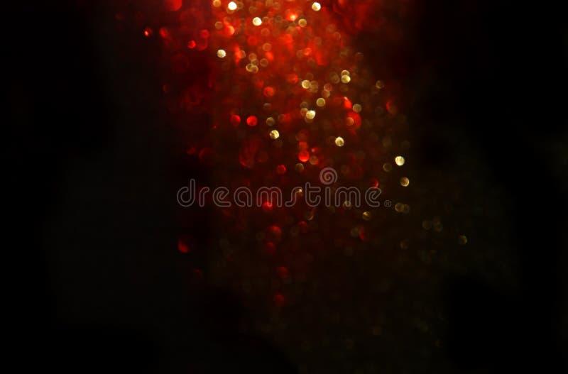 Rouge, noir et fond de lumières de vintage de scintillement d'or defocused photographie stock libre de droits