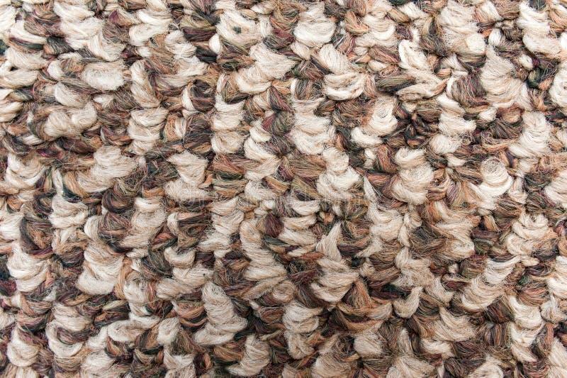 Rough brown camel wool fabric texture closeup stock image