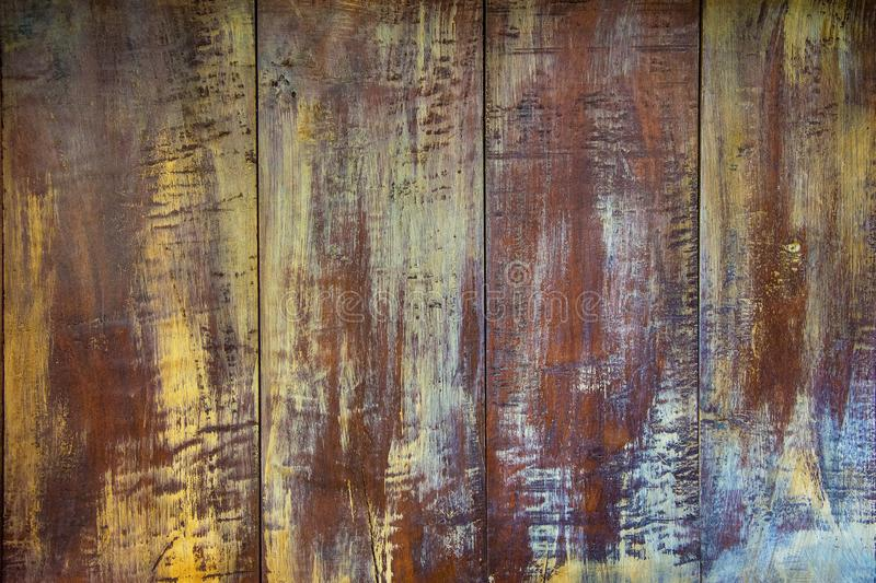 Rough brown- yellow panted wood texture. Background royalty free stock image