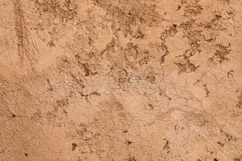 Rough crumbling texture of mud wall. Close up of the rough crumbling texture of traditional brown mud wall royalty free stock image