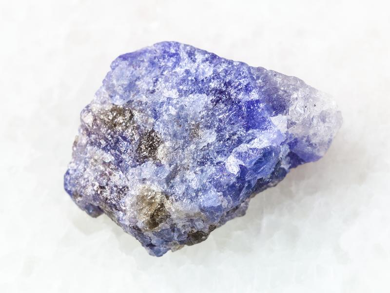 rough crystal of Tanzanite stone on white royalty free stock photography