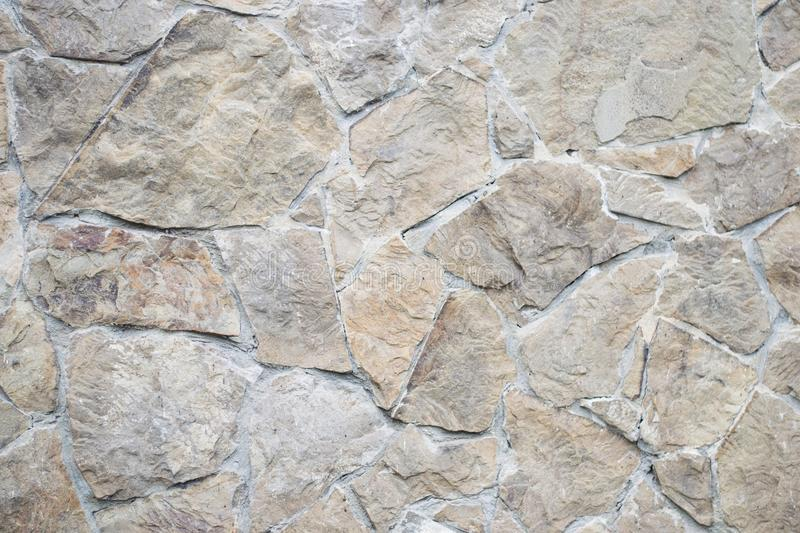 Rough detailed textured surface of old house. Top above close up view photo of brown with concrete stone wall, texture background royalty free stock image