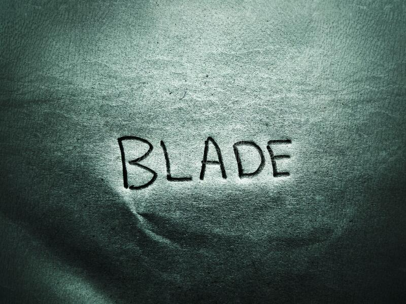 On the rough grain paper page the English word blade written by pencil royalty free stock photos