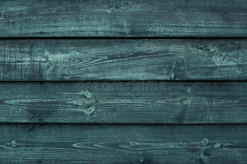 Rough green wooden boards. Weathered dark wood floor, barn, dilapidated fence. Hardwood texture grunge wall background. Rough green wooden boards. Weathered stock photography
