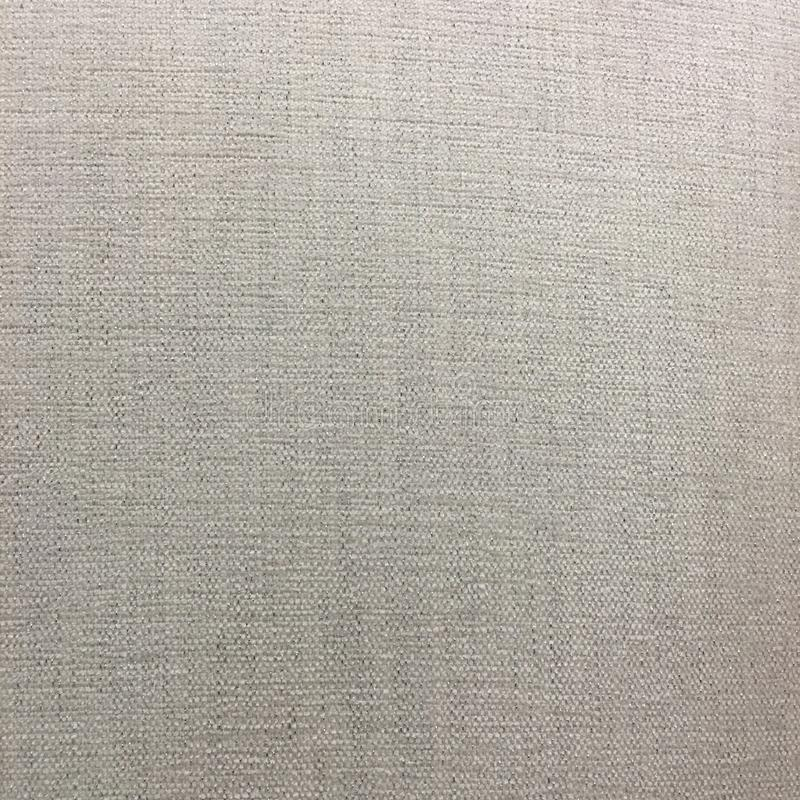 Rough hessian or cotton fabric texture. In off white royalty free stock images