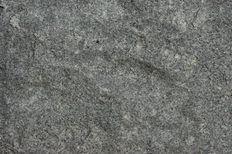 Rough hewn panel of igneous rock stock photos