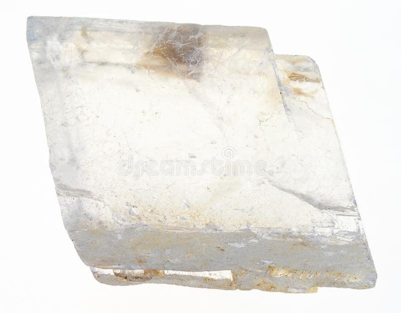 Rough iceland crystal (iceland spar ) on white. Macro photography of natural mineral from geological collection - rough iceland crystal (iceland spar stone) on stock image
