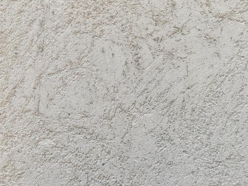 Rough light gray concrete wall texture. royalty free stock image