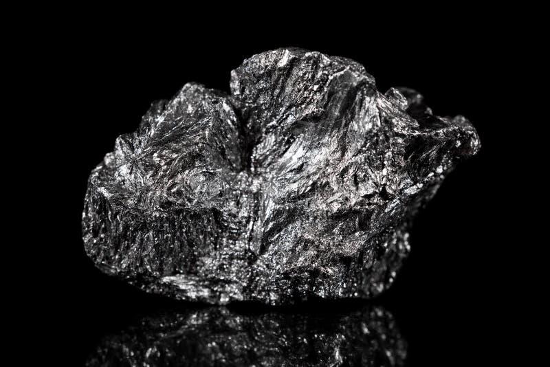 Rough mineral stone of Graphite, black specimen carbon. Black background stock images