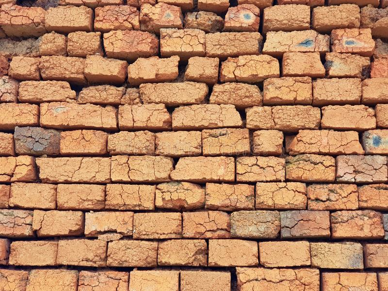Wall made of Bricks as Background. Rough not plastered bricks wall of an obsolete building royalty free stock photos