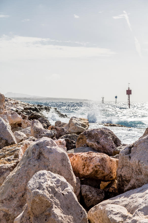 Rough Ocean Beyond Seawall. In Curacao royalty free stock images