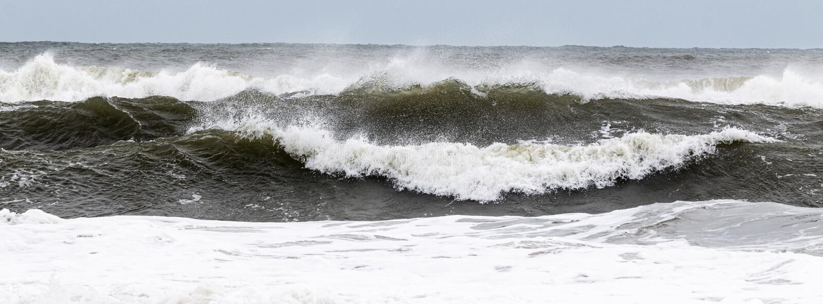 Rough ocean waves from tropical storm with heavy winds blowing the water royalty free stock photos