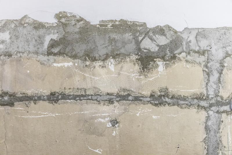 Rough peeled concrete wall background with whitewash royalty free stock photography