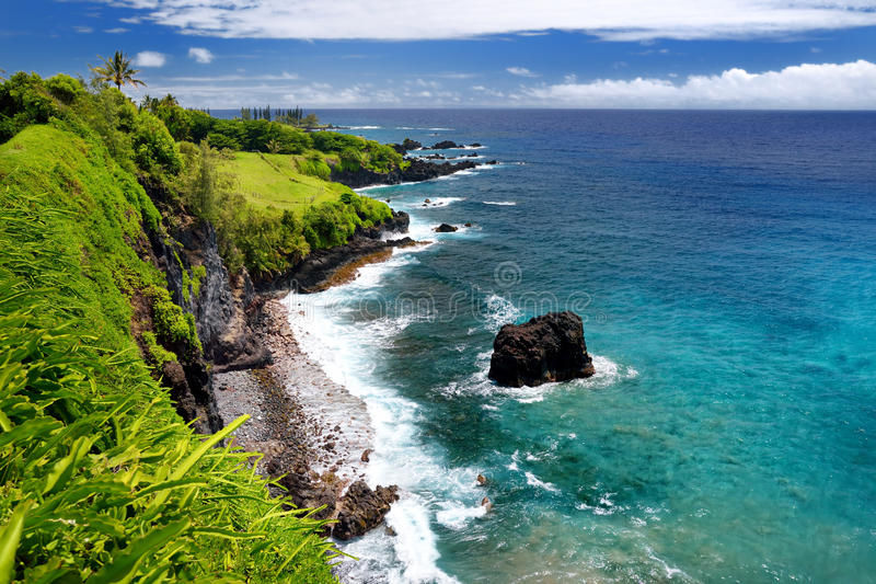 Rough and rocky shore at east coast of Maui, Hawaii stock image