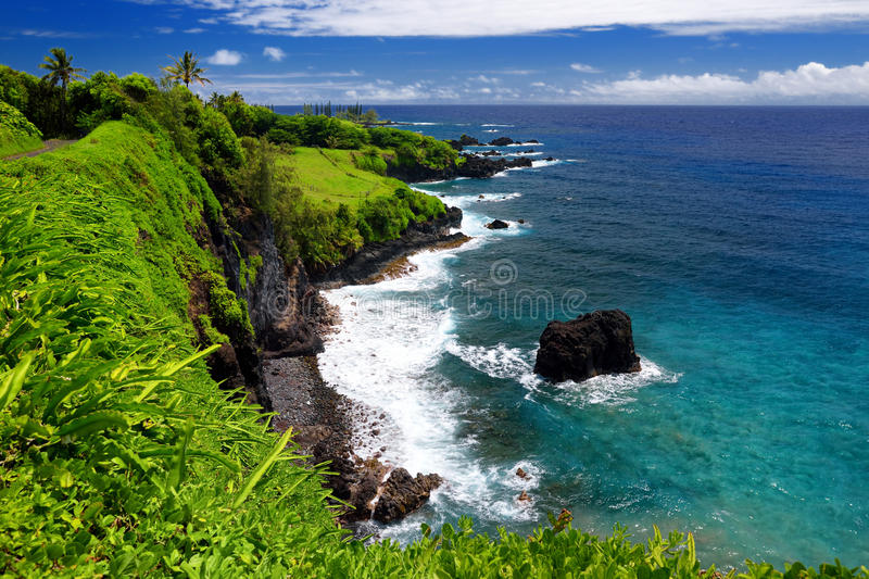 Rough and rocky shore at east coast of Maui, Hawaii stock images