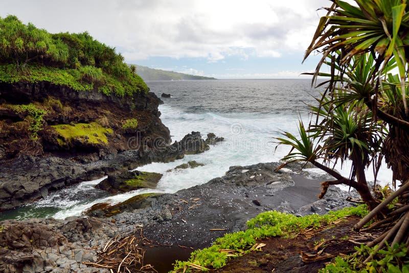 Rough and rocky shore at east coast of Maui, Hawaii stock photo