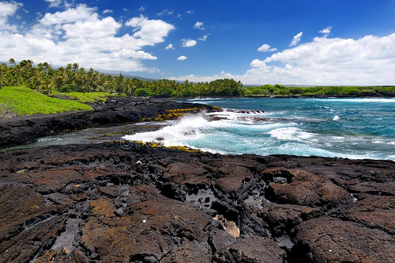 Rough and rocky shore at south coast of the Big Island of Hawaii royalty free stock image