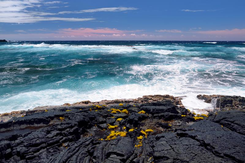 Rough and rocky shore at south coast of the Big Island of Hawaii royalty free stock images