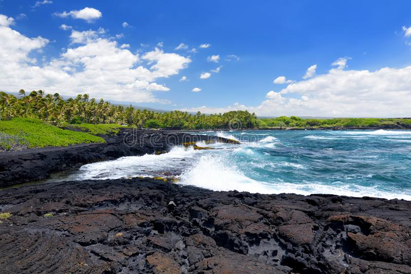 Rough and rocky shore at south coast of the Big Island of Hawaii stock images