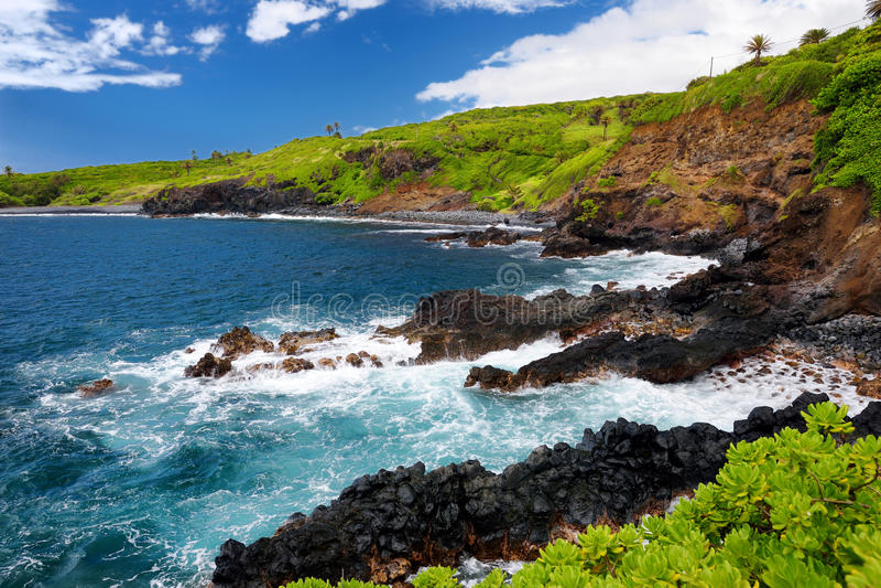 Rough and rocky shore at south coast of Maui, Hawaii royalty free stock photo