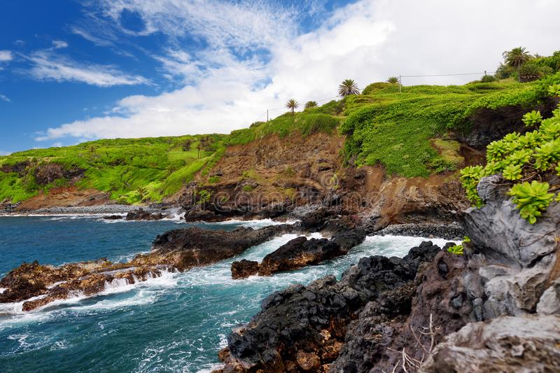 Rough and rocky shore at south coast of Maui, Hawaii royalty free stock images