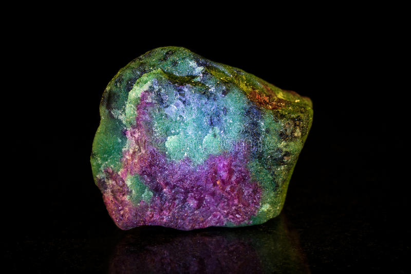 Rough Ruby With Zoisite In Front Of Black Stock Image