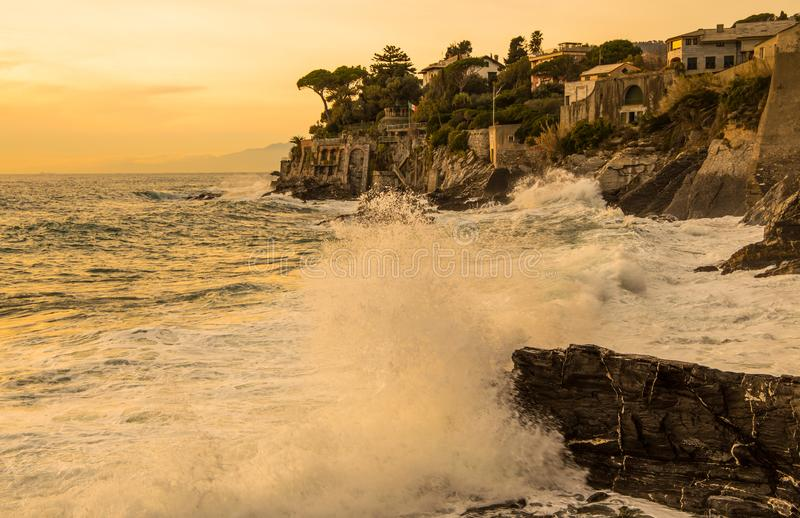 Rough sea on the coast at sunset, Genoa, Italy. stock images