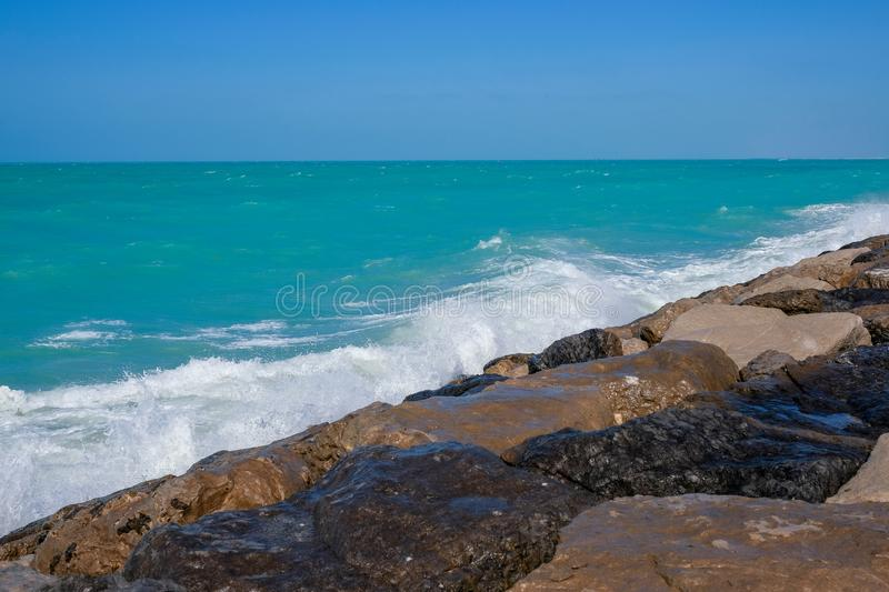 Rough sea and high waves. Crashing on shore aginst rocks boulder boulders danger ocean warning windy royalty free stock photos