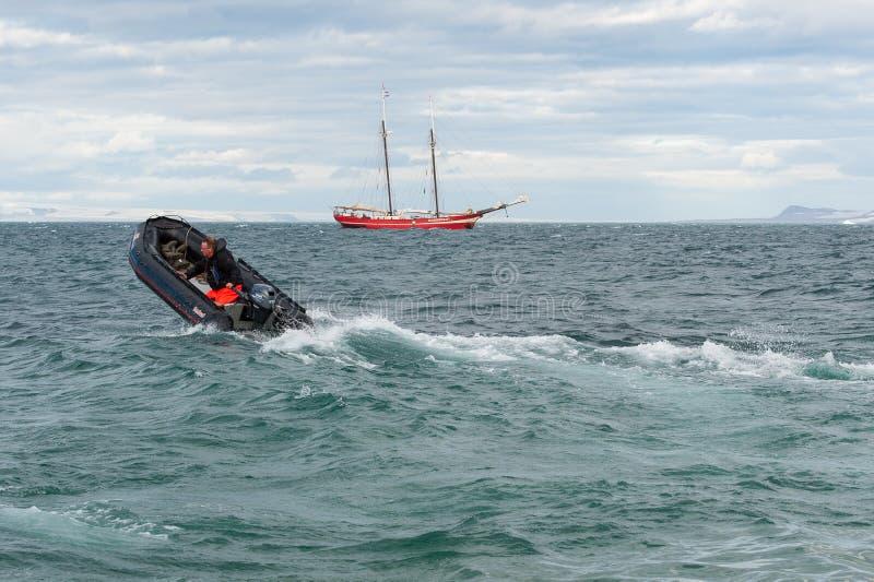 In rough sea - Kodiak returning to mothership, Svalbard stock image