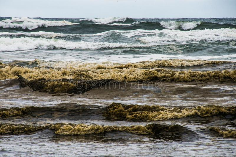Rough Sea With Rolling high Waves Crushing Unto One Another During The Storm On The Coastal Of Long Beach Washington. The bottom sand was washed up to the top royalty free stock image