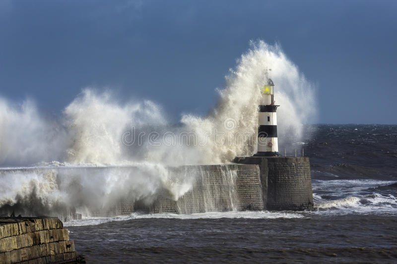 Rough Sea - Seaham Lighthouse - England. Waves crashing over Seaham Lighthouse on the northeast coast of England