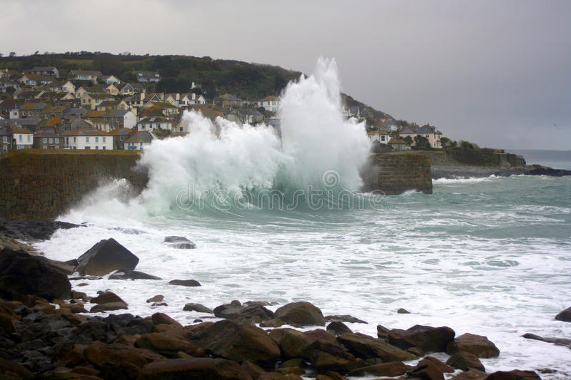 Rough seas breaking on breakwater. At the port of Mousehole in Cornwall, England stock photography