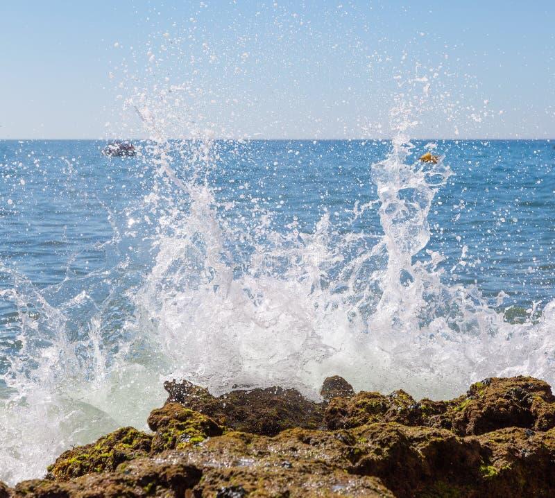 Rough seas crashing against rocks in Carvoiero. Portugal royalty free stock photos