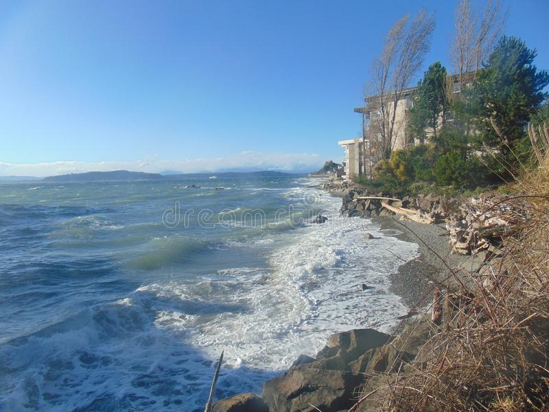 Rough seas at the Seattle coastline. Windy weather produces large waves along the Seattle coastline royalty free stock photos
