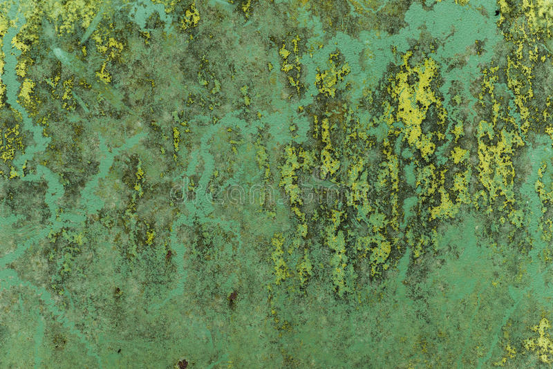 Rough and stained green metal surface. Grungy industrial metallic texture on stained sheet of metal royalty free stock photography